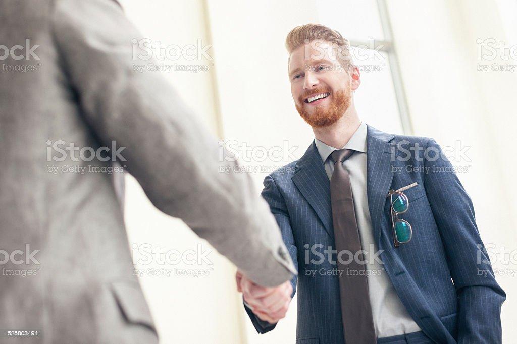 Businessman shaking hands stock photo