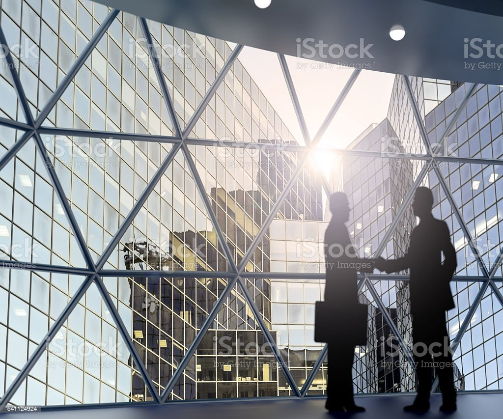businessman shaking hands stock photo