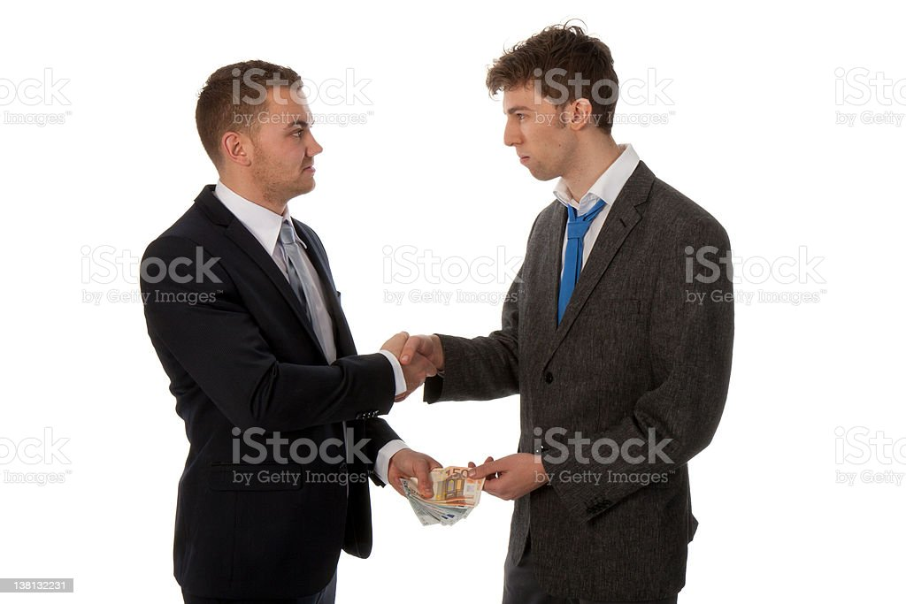 Businessman shaking hands. The deal is made and payed. royalty-free stock photo