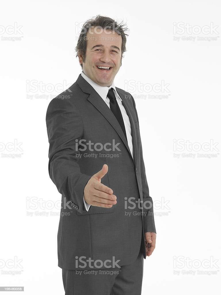 Businessman shaking hands to seal a deal royalty-free stock photo