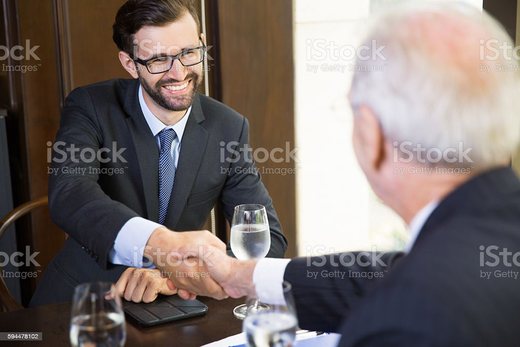 Businessman Shaking Hands with Partner stock photo