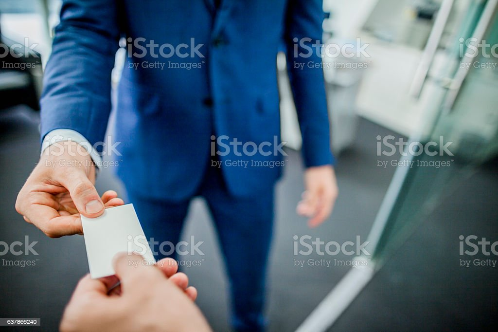 Businessman sharing business card stock photo
