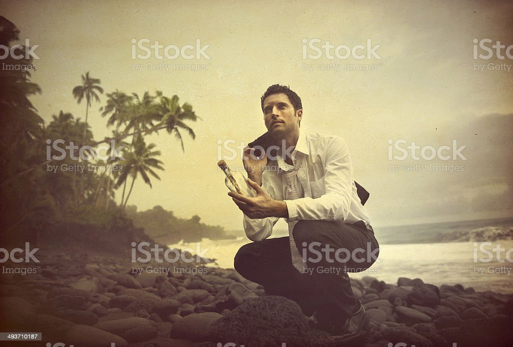Businessman Shipwrecked on a desert island stock photo