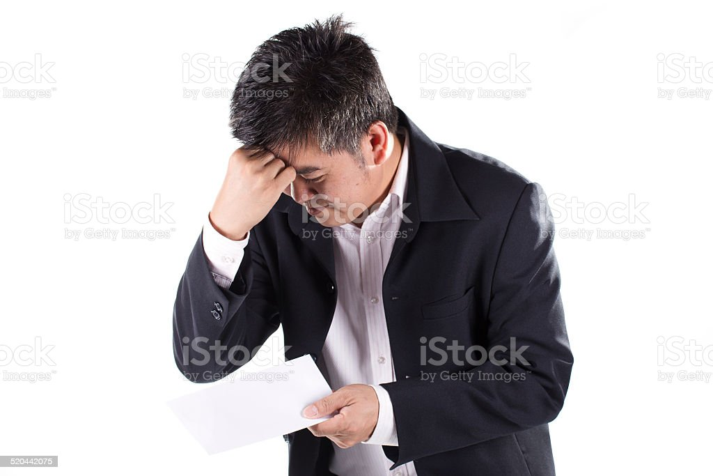 Businessman Shocked received layoff notice stock photo
