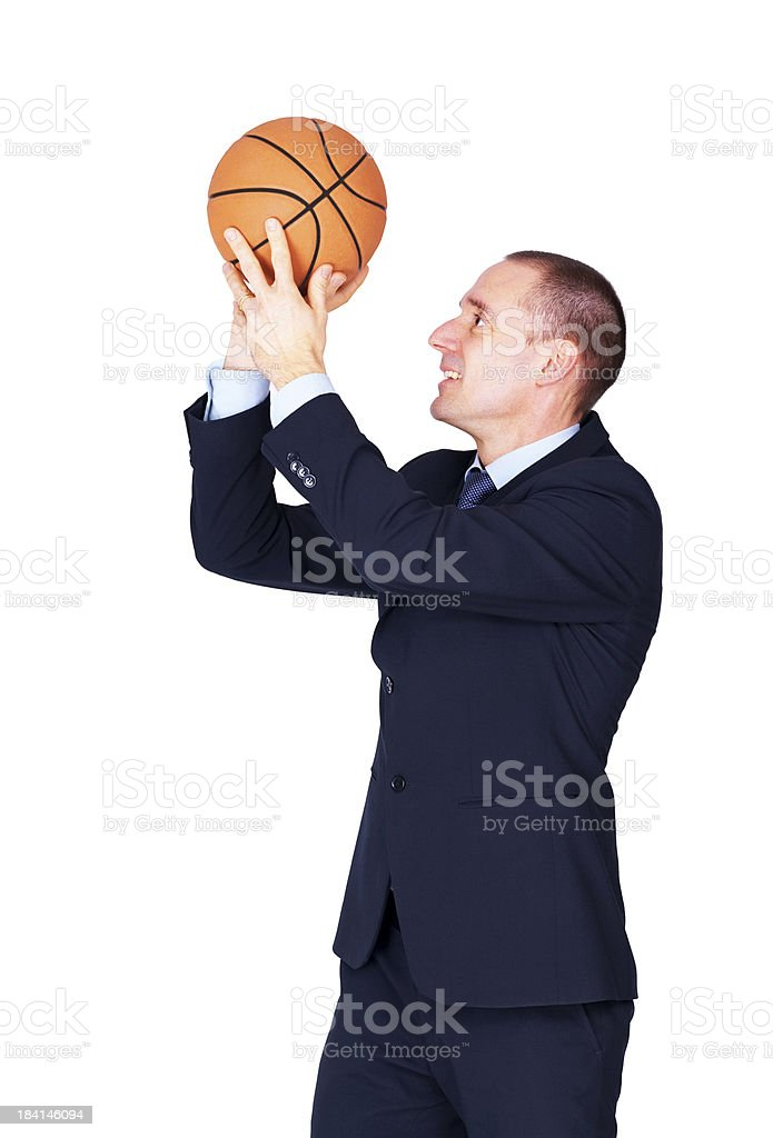 Businessman shooting basketball away over white royalty-free stock photo