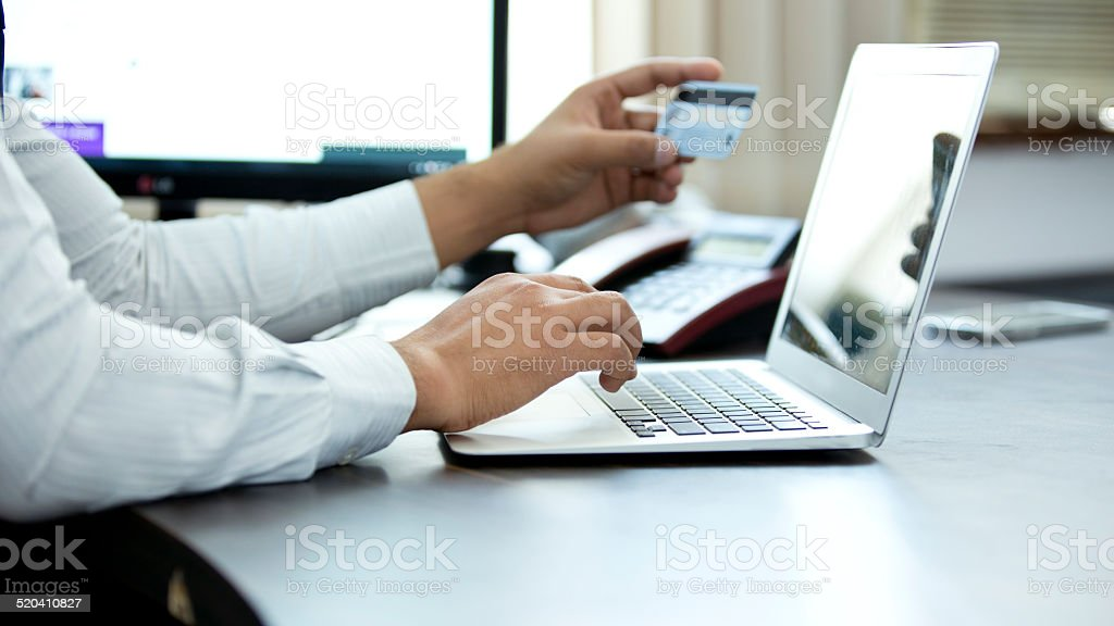 Businessman shopping online stock photo