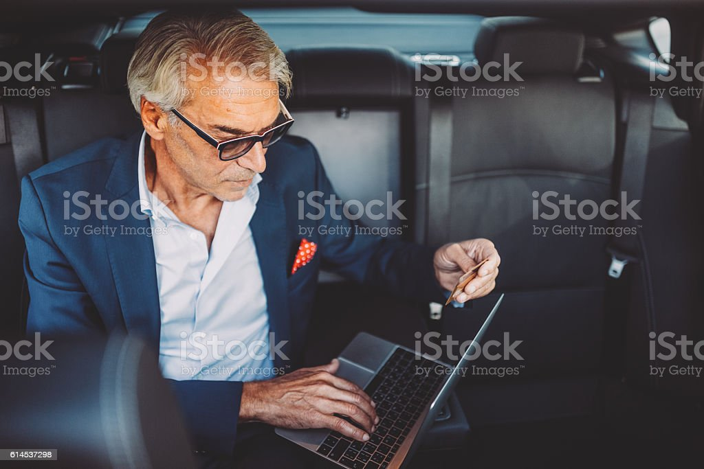 Businessman shopping with credit card stock photo
