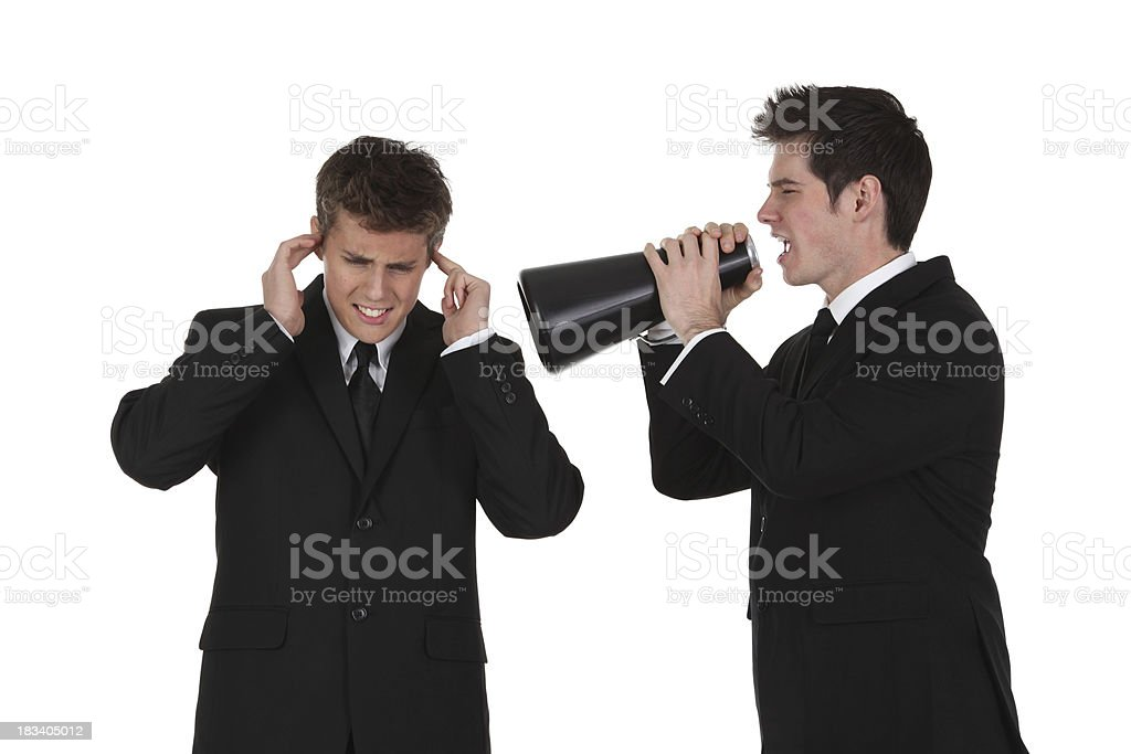 Businessman shouting at employee with megaphone royalty-free stock photo