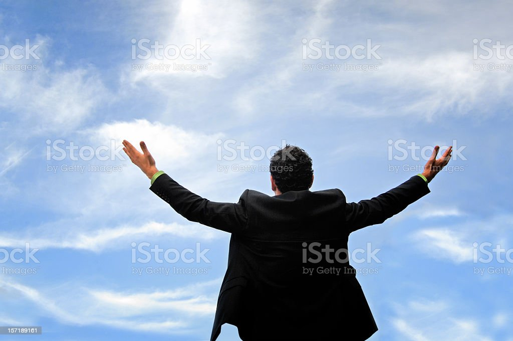 Businessman shouting his victory to the world royalty-free stock photo