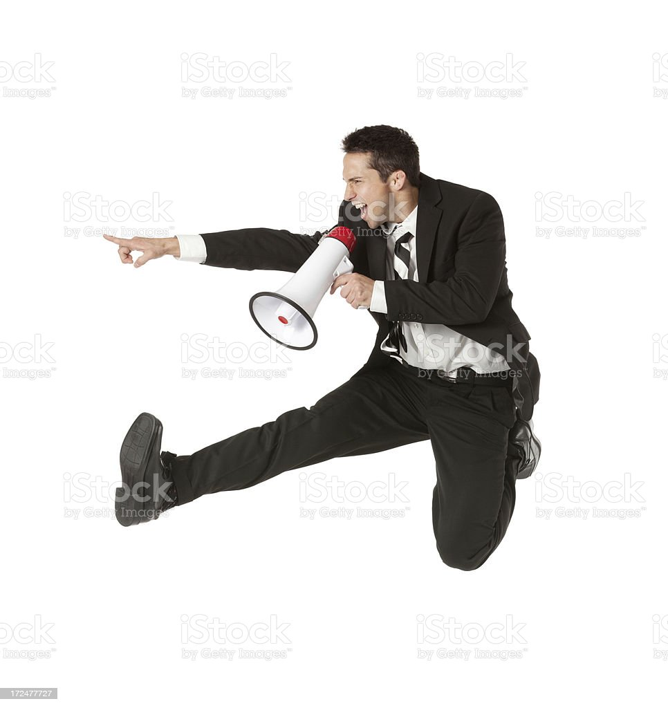 Businessman shouting into a bullhorn and pointing royalty-free stock photo