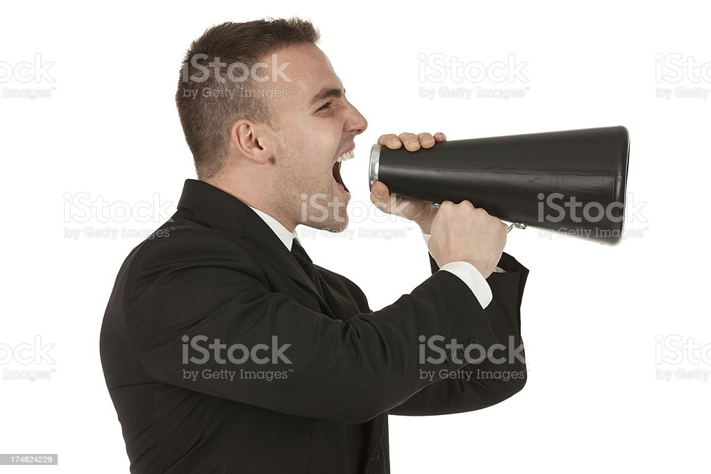 Businessman shouting into a bullhorn royalty-free stock photo