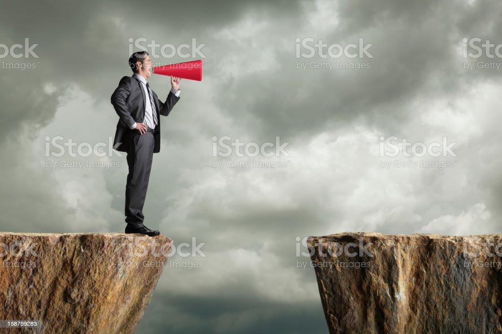 Businessman Shouting Into Megaphone stock photo
