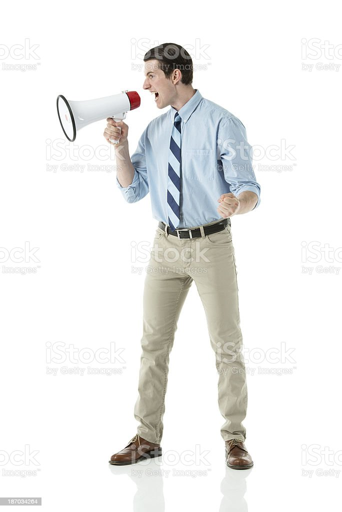 Businessman shouting on a megaphone royalty-free stock photo