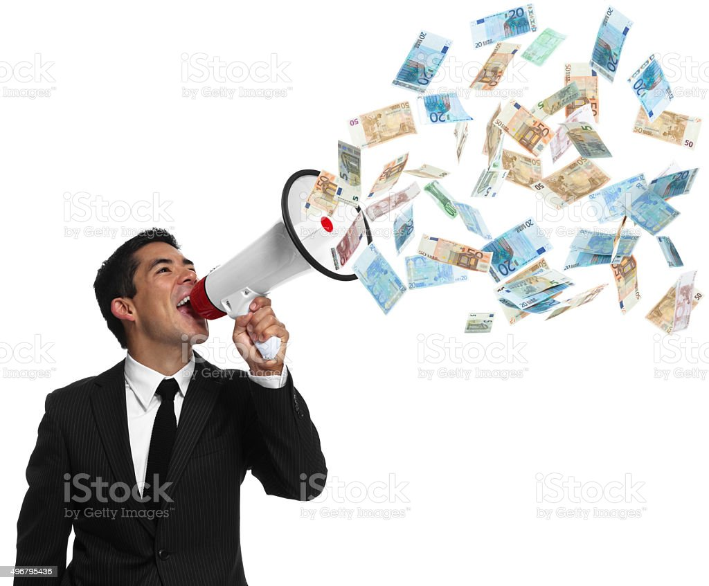 Businessman Shouting up into a bullhorn stock photo