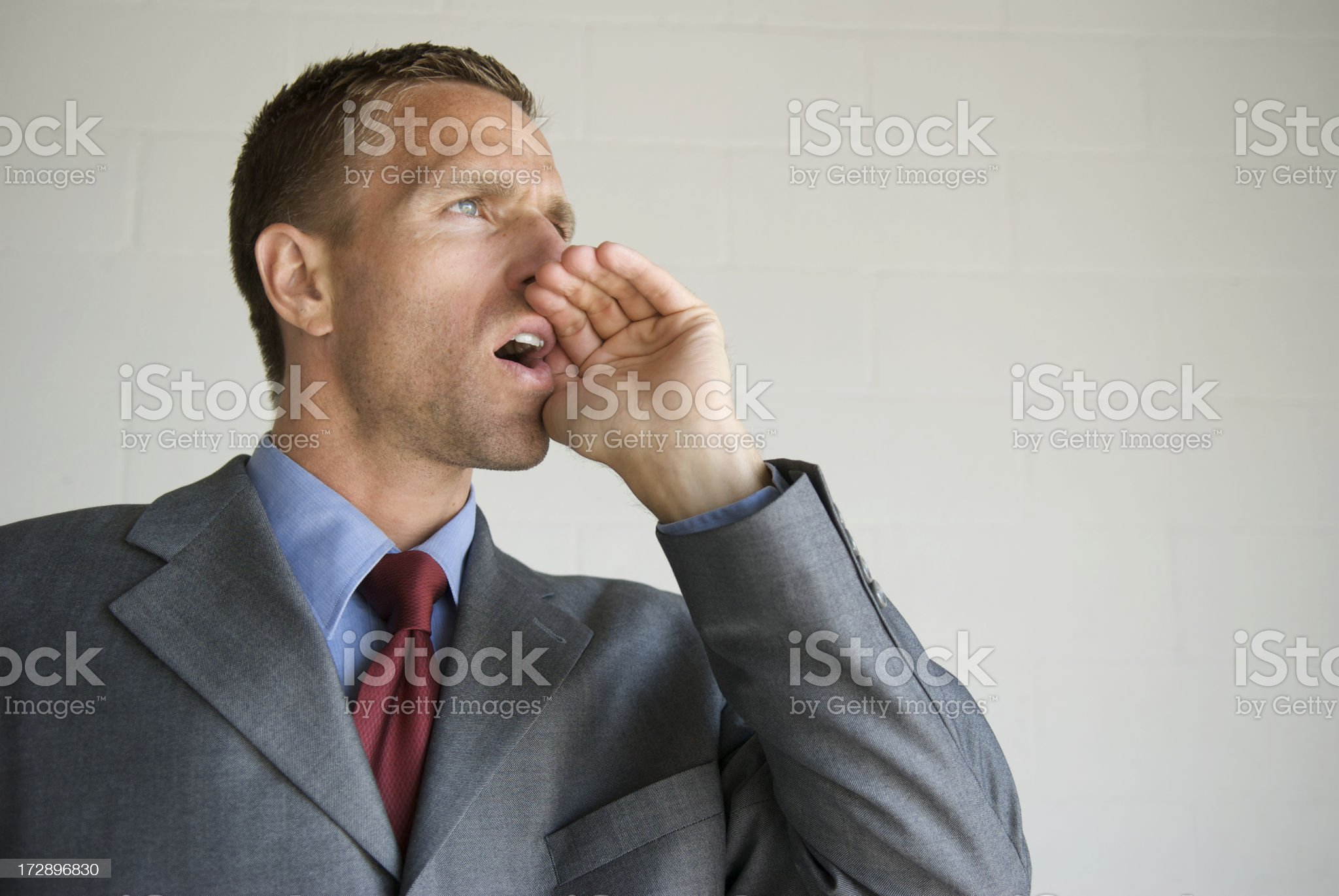 Businessman Shouts into Copy Space royalty-free stock photo
