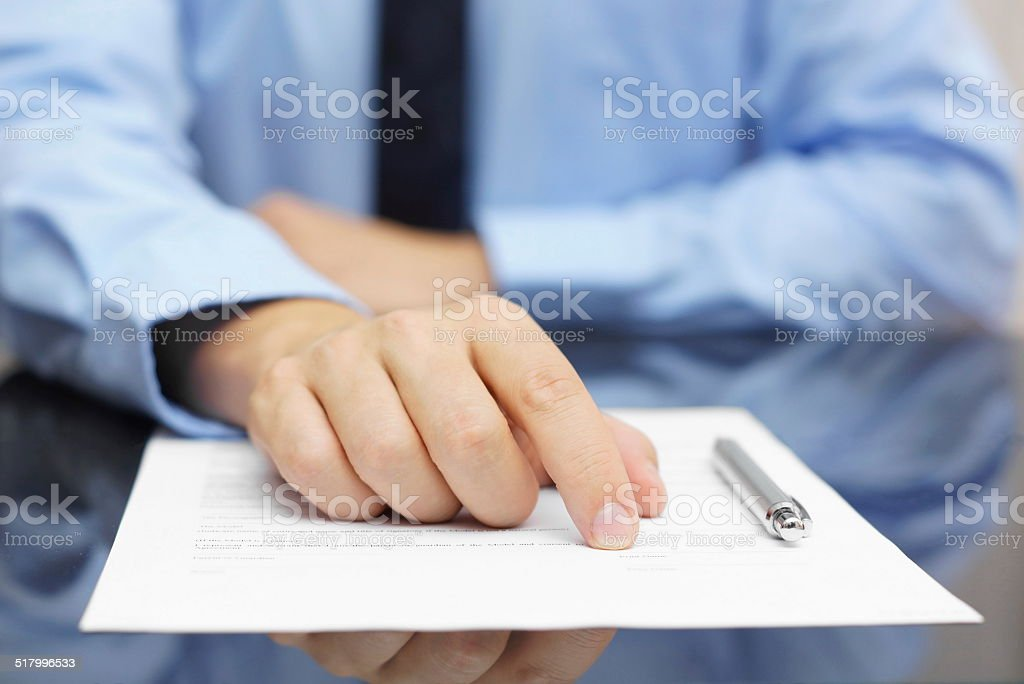 businessman show client where to sign stock photo