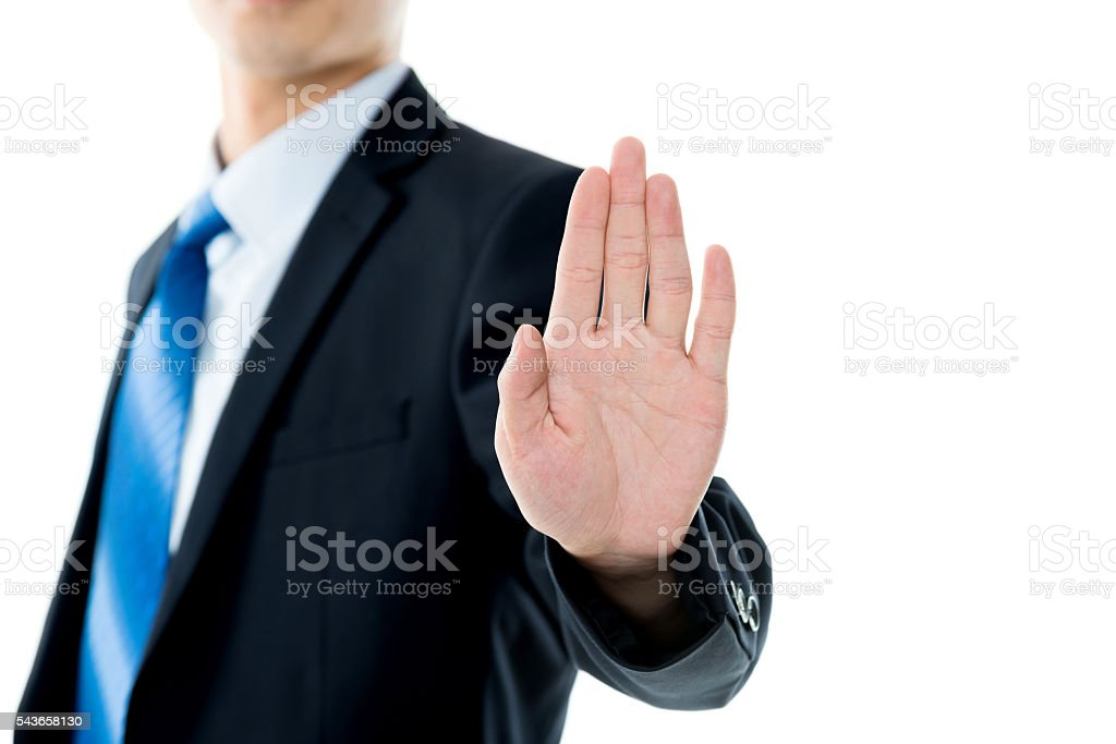 Businessman show STOP against white background stock photo