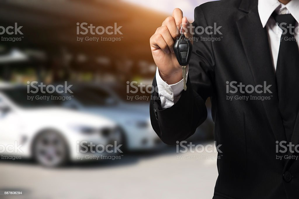 businessman showing a car key - car sale & rental stock photo