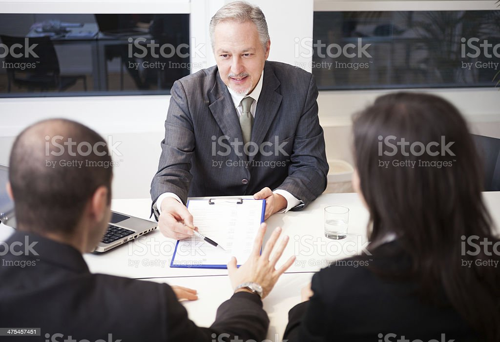 Businessman showing a document stock photo