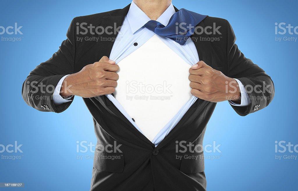 Businessman showing a superhero suit stock photo