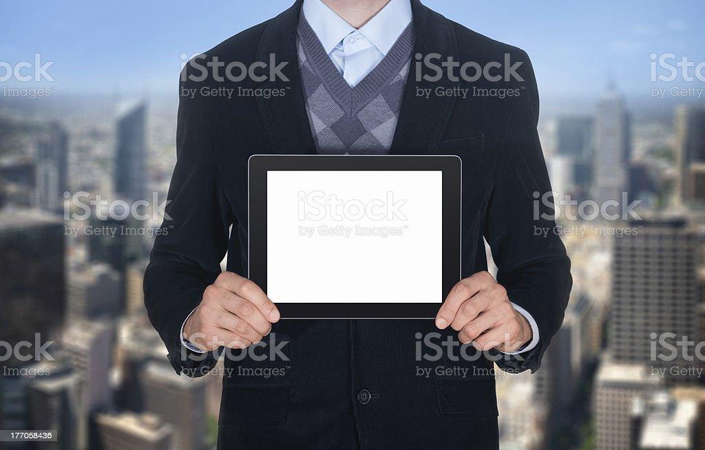 Businessman showing blank digital tablet royalty-free stock photo