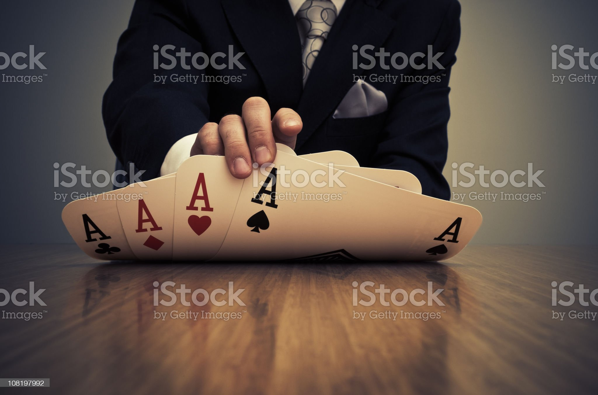 Businessman Showing Card Hand of Aces royalty-free stock photo