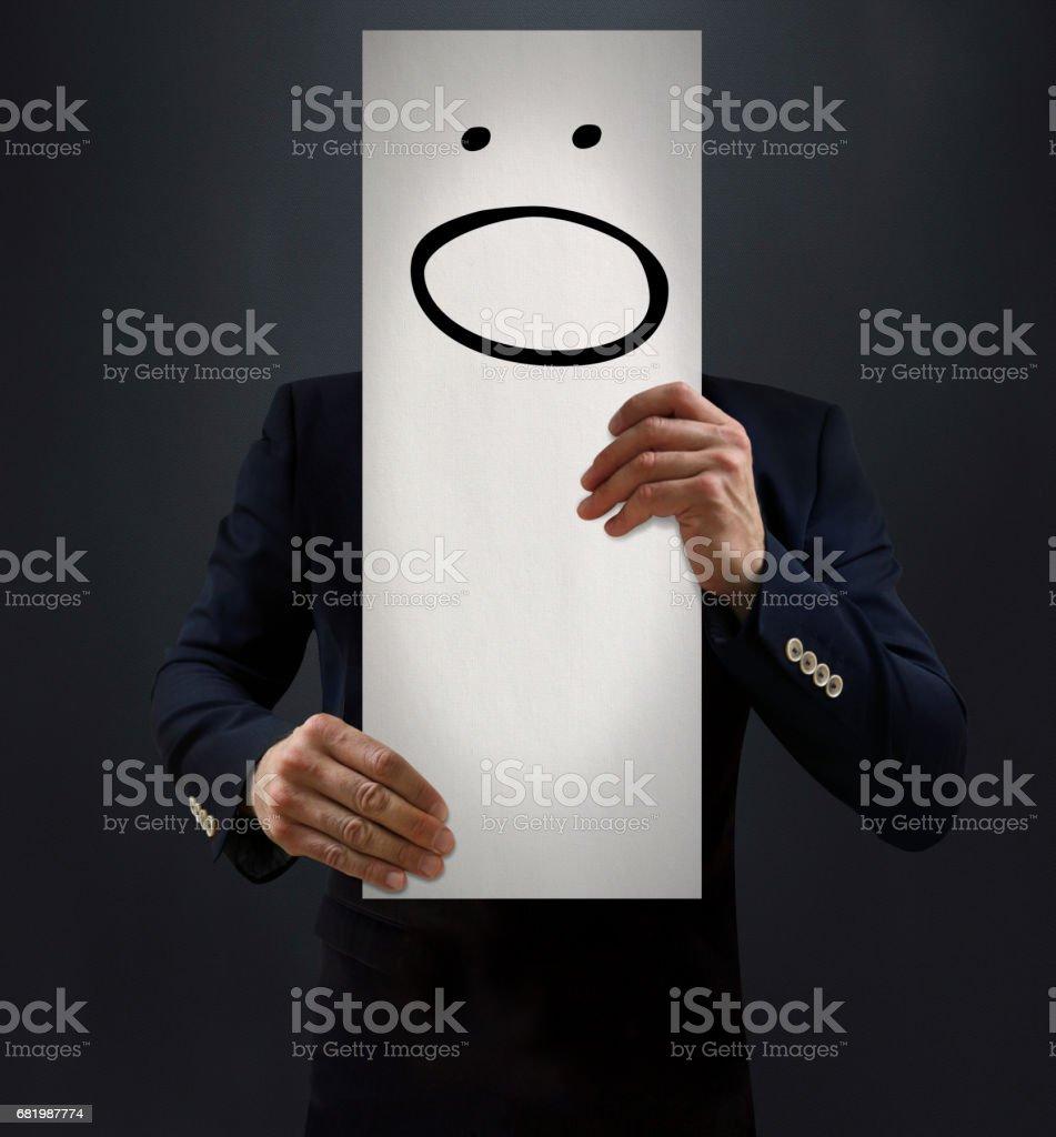 Businessman Showing Confused Emoji Board stock photo