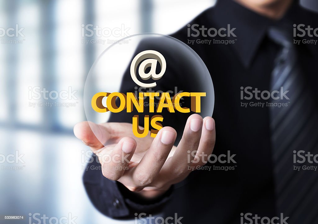 Businessman showing 'contact us' text in crystal ball stock photo
