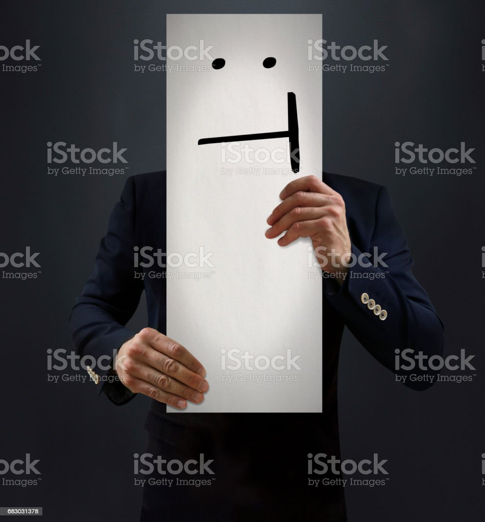 Businessman Showing Dead Pan Emoji Board stock photo