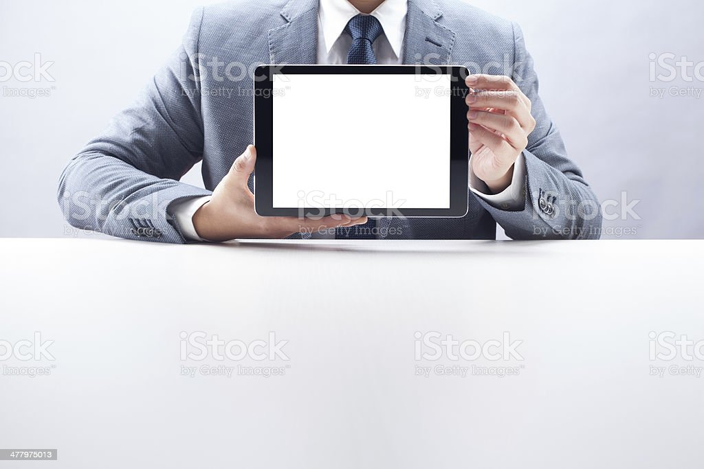 Businessman Showing Digital Tablet royalty-free stock photo