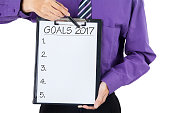 Businessman showing goal 2017 on the clipboard