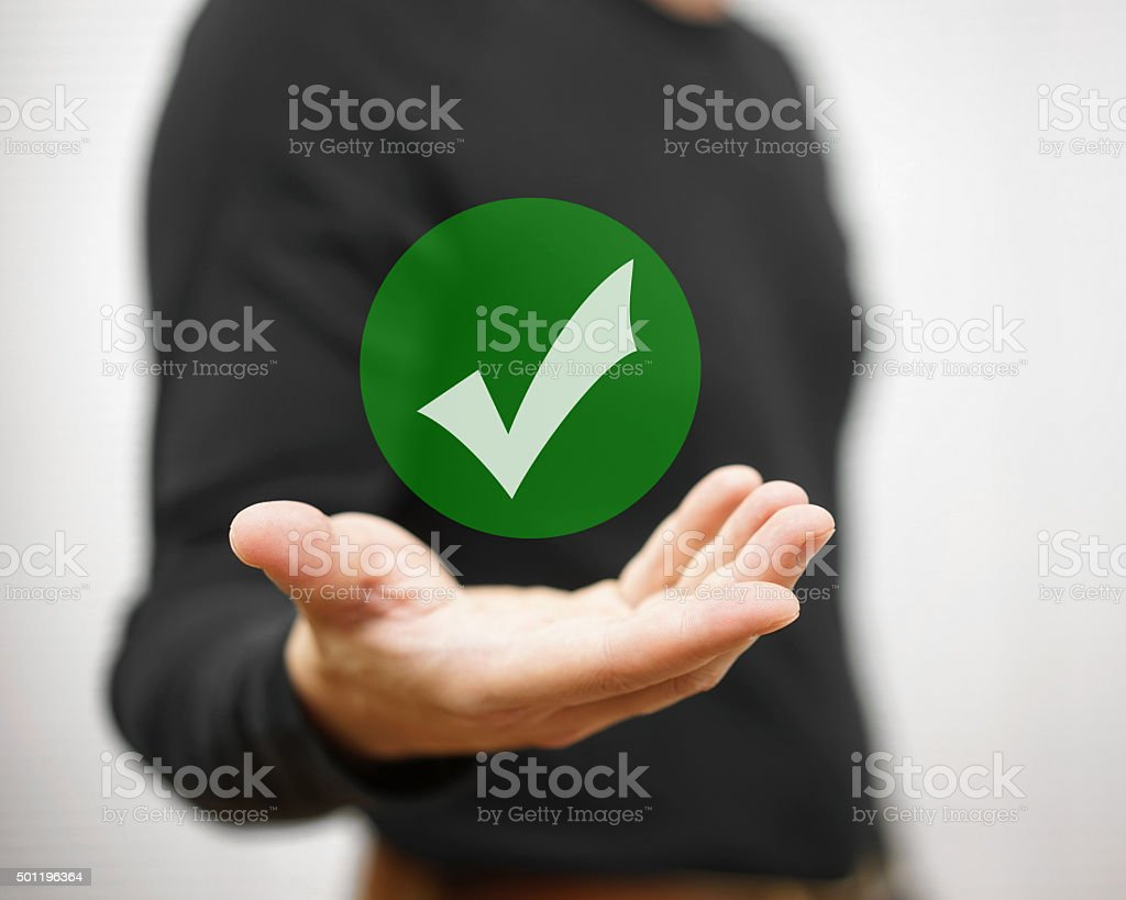 Businessman showing green check mark. Concept of correct decision stock photo
