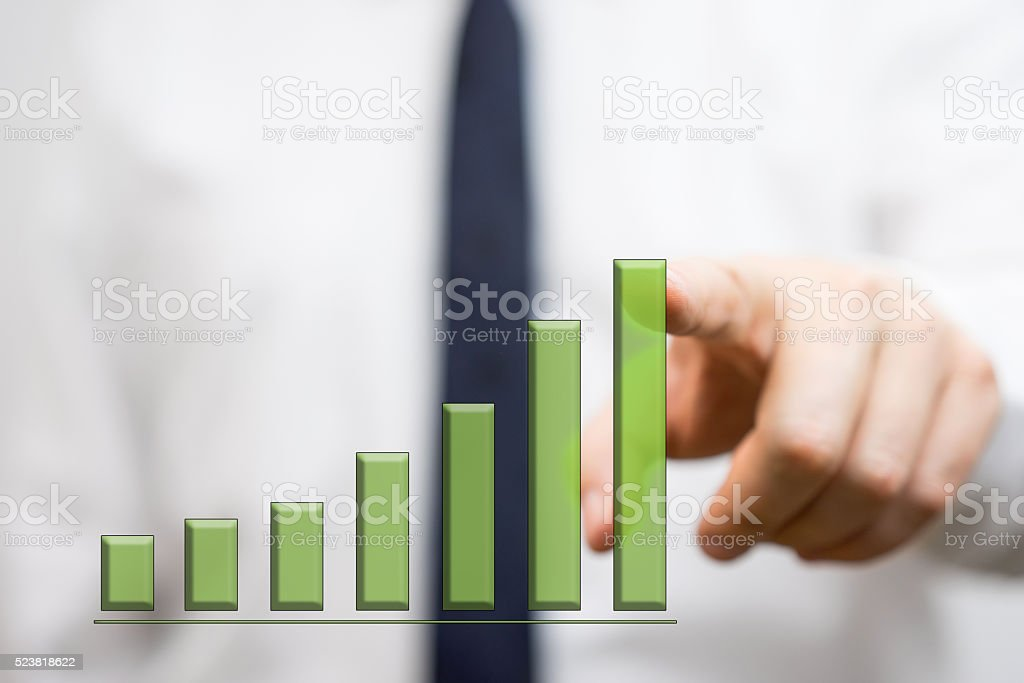 businessman showing growing graph stock photo