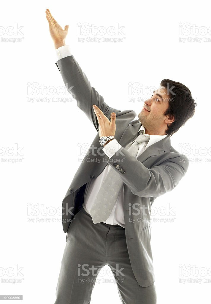 businessman showing imaginary product royalty-free stock photo