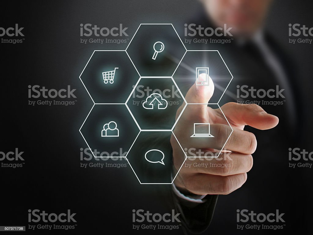 Businessman Showing Interactive Hexagon Buttons stock photo