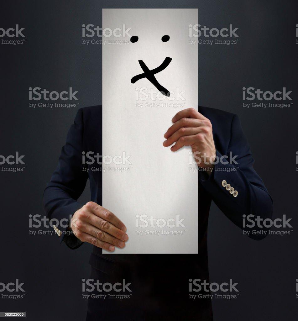Businessman Showing Kissing Emoji Board stock photo
