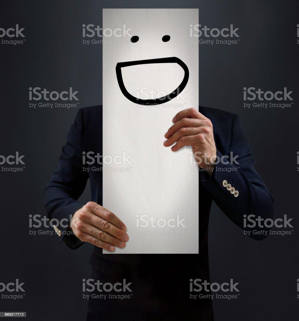 Businessman Showing Laughing Emoji Board stock photo