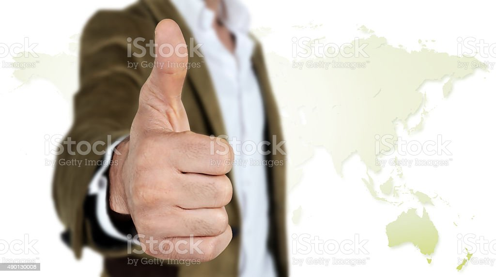 Businessman showing OK sign with his thumb up stock photo