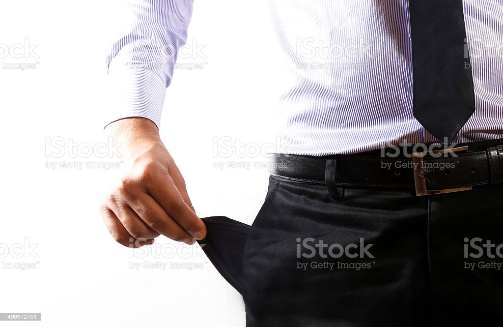 Businessman showing out his empty pocket royalty-free stock photo
