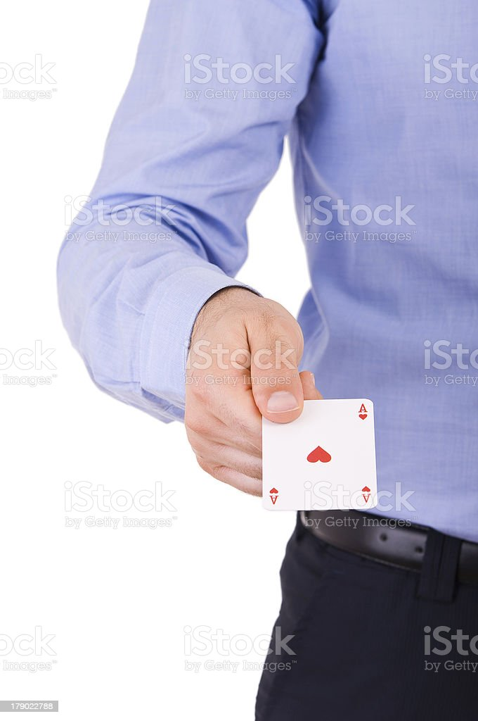 Businessman showing playing card. royalty-free stock photo