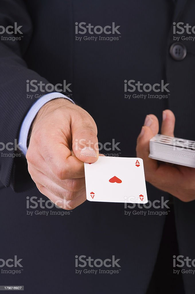 Businessman showing playing cards. royalty-free stock photo