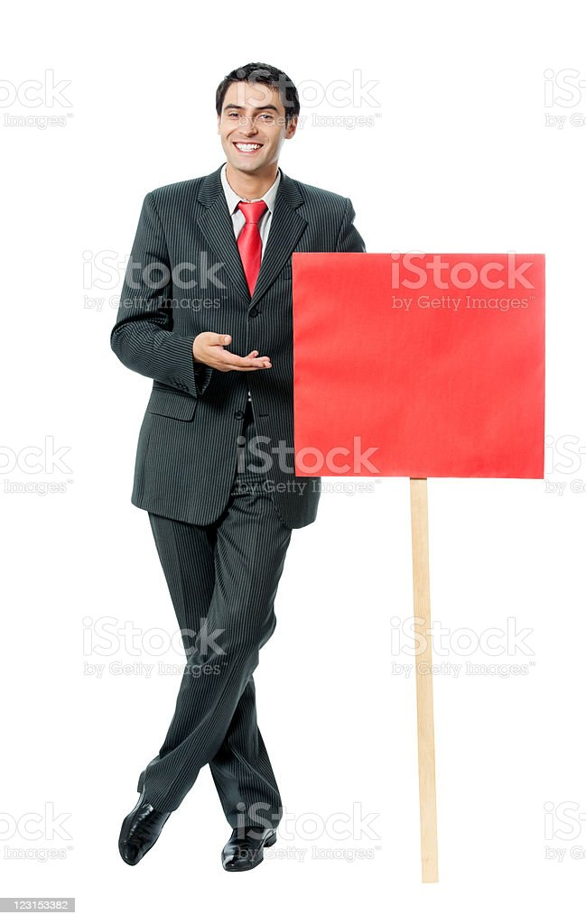 Businessman showing red signboard, isolated royalty-free stock photo