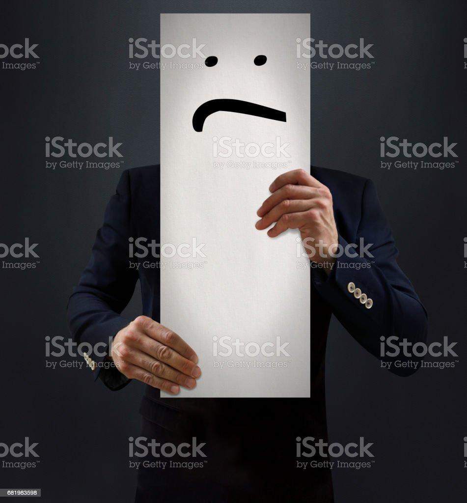 Businessman Showing Sad Emoji Board stock photo