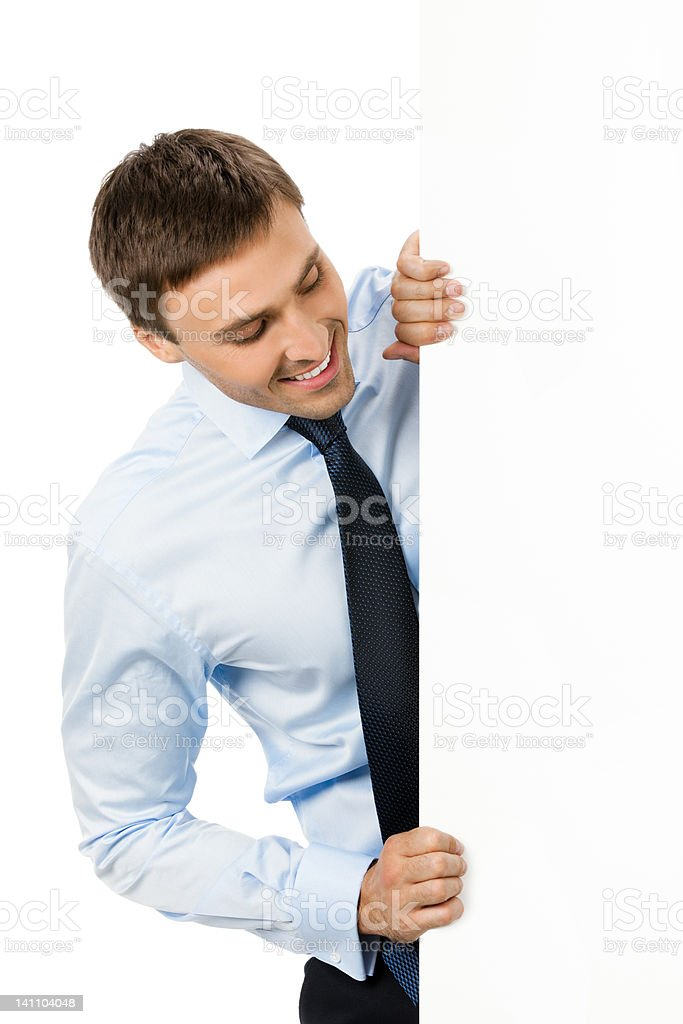 Businessman showing signboard, on white royalty-free stock photo