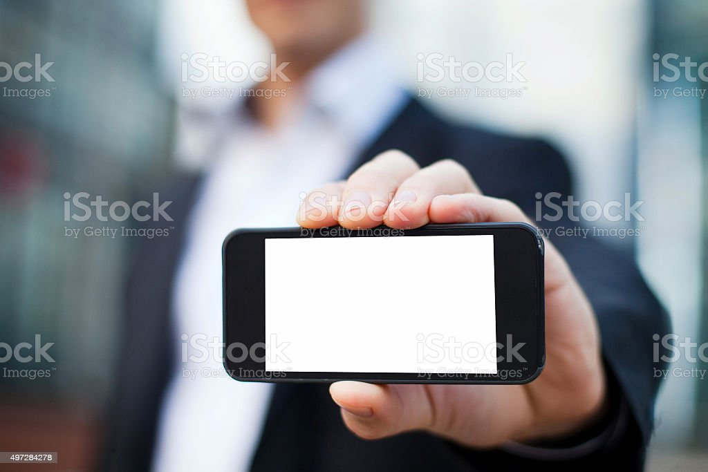 businessman showing smartphone stock photo