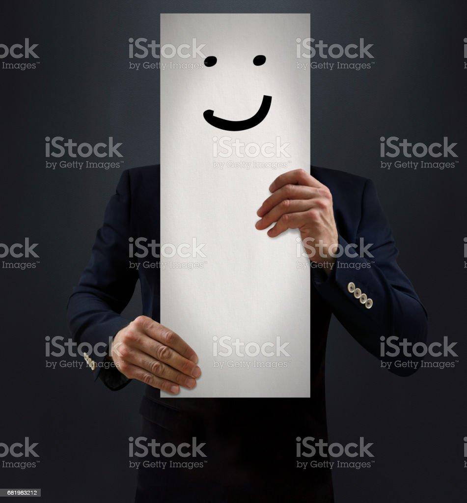 Businessman Showing Smiling Emoji Board stock photo