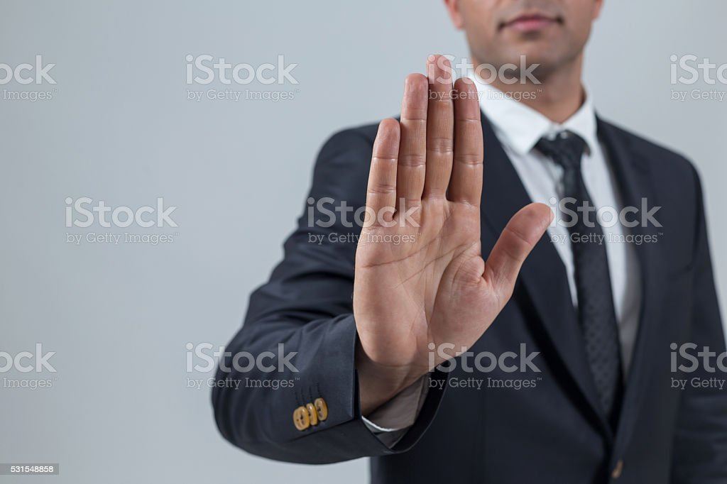 Businessman showing stop with hand stock photo