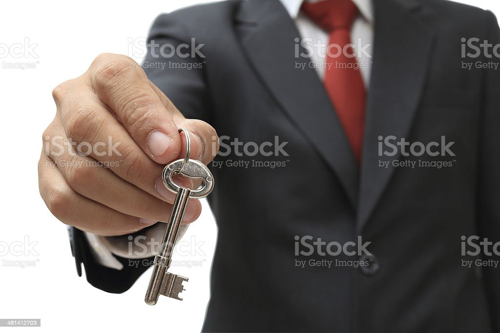 businessman showing the silver key to success isolate on white stock photo