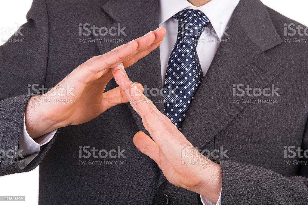 Businessman showing time out sign with hands. stock photo