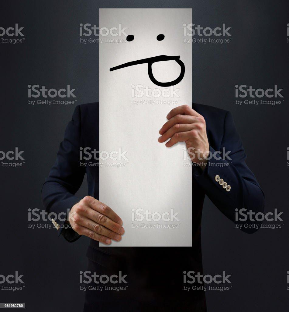 Businessman Showing Tongue Emoji Board stock photo
